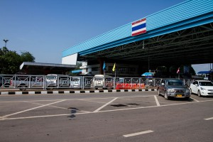 At the Thai Laos border, you exit on the left-hand side.